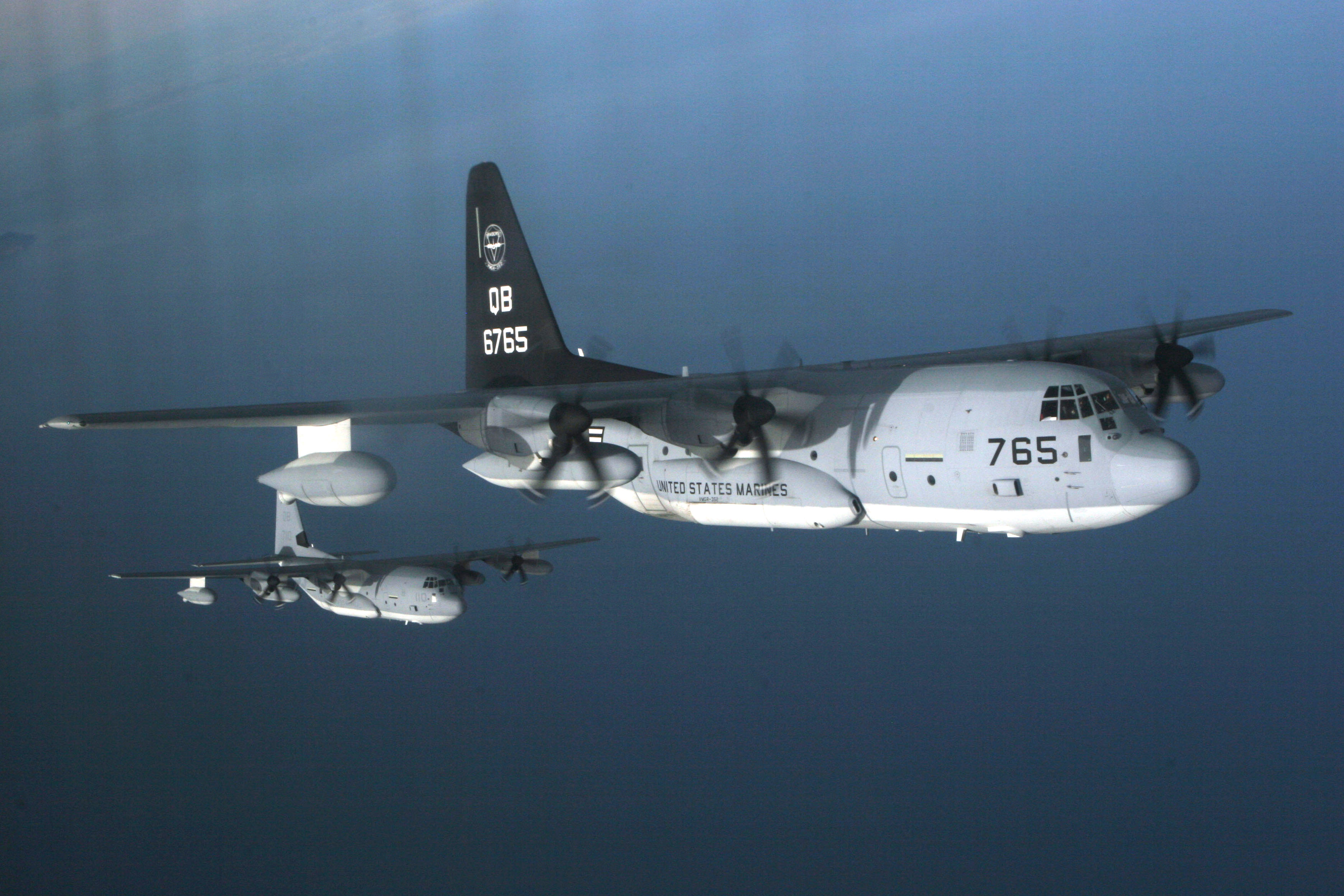 Two KC-130J Hercules aircraft, assigned to Marine Aerial Refueler Transport Squadron (VMGR) 352, stagger themselves during a refueling training exercise off the coast of Southern California